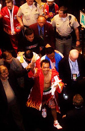 Boxing career of Manny Pacquiao - Pacquiao leaving the ring while giving the V sign to the crowd on the night of the first fight against Morales