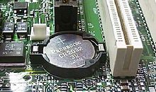Panasonic CR2032 button cell on computer motherboard.jpg