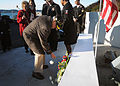 Pearl Harbor lays carnation at USS Arizona memorial 131206-N-DX364-203.jpg