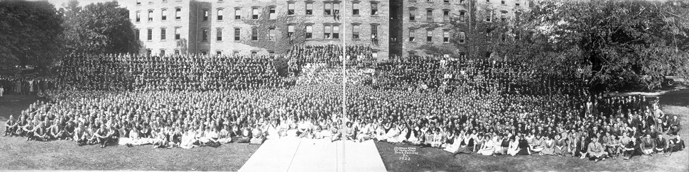 Students sit outside Pennsylvania State College (c. 1922).
