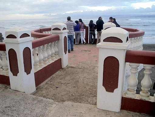 The Agustín Ross Balcony, with people looking at the sea and taking photographs, on Friday. Image: Diego Grez.
