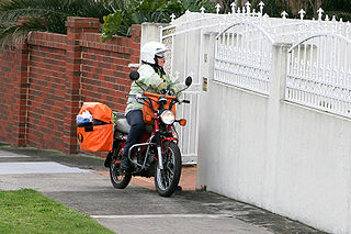 Mail carrier employee of the post office or postal service, who delivers mail to residences and businesses
