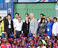 President Clinton and Secretary Clinton Pose for a Photo With Workers at Caracol Industrial Park (8122239533) (cropped).jpg