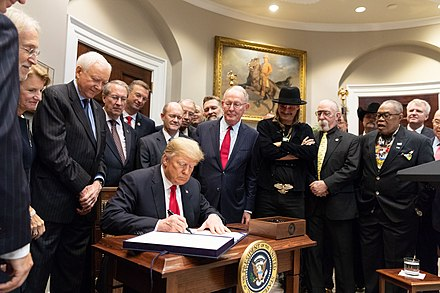 Portnow (to the left of US President Donald Trump) as the Music Modernization Act is signed into law in 2018 President Donald J. Trump signs the Music Modernization Act (45200025962).jpg