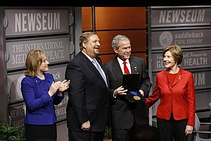 Rick Warren - Kay and Rick Warren (left of picture), President George W. Bush, with Laura Bush at his side, with the International Medal of Peace at the Saddleback Civil Forum on Global Health in Washington, D.C.