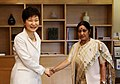 President Park Geun-hye shakes hands with the Lok Sabha Opposition Leader Sushma Swaraj.jpg