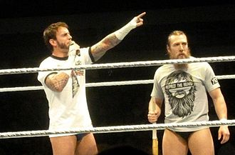 Survivor Series (2013) - CM Punk (left) and Daniel Bryan allied together to feud with The Wyatt Family heading into Survivor Series.