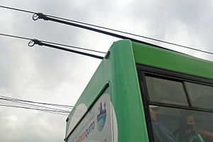 Trolleybuses in Quito - Detail view of the ends of the trolley poles and trolley-heads on the catenary or overhead lines