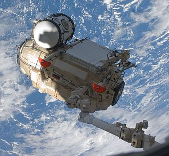 Mobile Servicing System - Canadarm2 moves Rassvet to berth with the station on STS-132, 2010