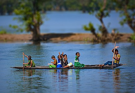 Children in a boat on the Shari-Goyain River in Ratargul Swamp Forest, Bangladesh.