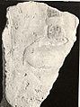 Relief fragment- hand of Nubian (?) with water skin and monkey om lead MET 13.235.11.jpeg