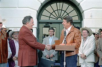 Ronald Reagan presenting Congressional Gold medal to Louis L'Amour C17215-24.jpg