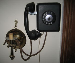 Rotary dial wall telephone. c. 1930s. Also see...