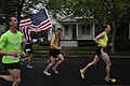 Runners carry the country's Colors during the 6th Annual Historic Half Marathonin, Fredericksburg, Va., May 19, 2013 130519-M-WG312-083.jpg
