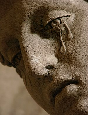 Sadness - A detail of the 1672 sculpture Entombment of Christ, showing Mary Magdalene crying