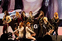 A photograph of Girls' Generation performing at the LG Cinema 3D World Festival in 2012