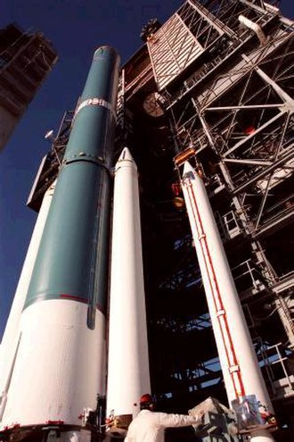 Solid rocket booster - NASA Image of a solid rocket booster (right) being mated to a Delta II rocket (blue). Two boosters (white) can be seen already attached.