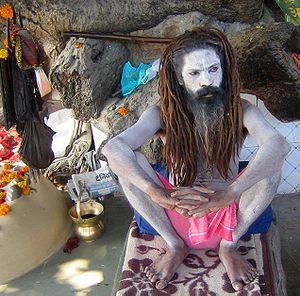 Kamandalu - A sadhu (ascetic) with a kamandalu to his right