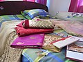 Saris, ornament, wedding cards in a bed 03.jpg