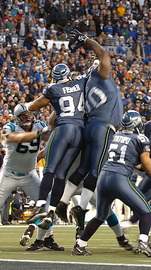 Seattle Seahawks - Members of the Seahawks special teams blocking a point-after attempt against the Carolina Panthers