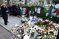 Secretary Kerry, Ambassador Hartley Prayer Over Flowers Left in Memory of Slain Paris Police Officer (16290467021).jpg