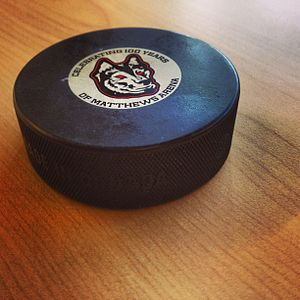 Sher-Wood - A Sher-Wood hockey puck commemorating the 100-year anniversary of Matthews Arena at Northeastern University.
