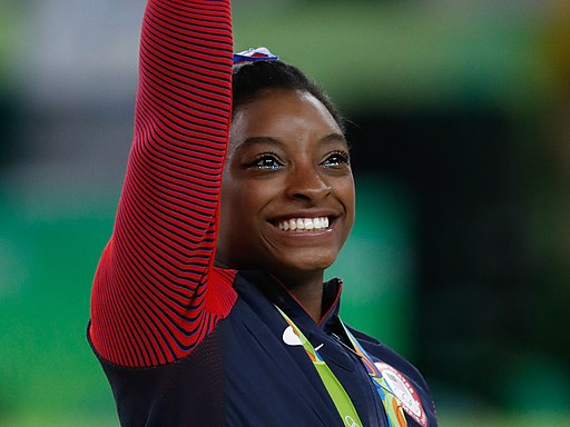 Simone Biles at the 2016 Olympics all-around gold medal podium (28262782114) cropped