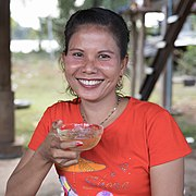 Smiling woman holding a cup of beer.jpg