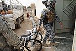 Soldiers, Iraqi national policemen distribute school supplies in Baghdad DVIDS157191.jpg