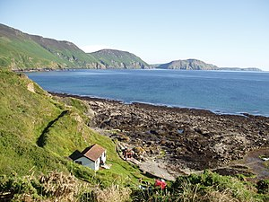 Niarbyl, Isle of Man - View to the south across Niarbyl Bay of the southwest coastline of Isle of Man and Calf of Man.