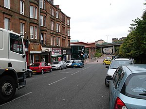 Springburn - The old alignment of Springburn Road, leading to Balgrayhill. The Springburn Leisure Centre at Kay Street, opened on 17 November 1988 and expanded to include a large swimming pool in 1995, is located on the left and the Springburn Shopping Centre, opened in 1981, is located on the right.