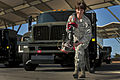 SrA Crystal Lane, 99th Logistics Readiness Squadron, pulls a fuel hose from an R-11 fuel truck at Nellis AFB.jpg