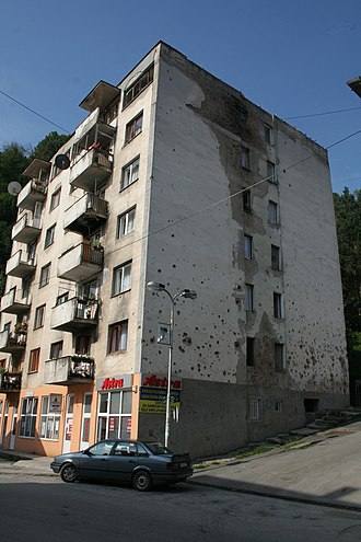 Srebrenica massacre - Damaged building in Srebrenica after the war