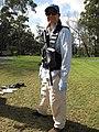 Starr-091028-8635-Eucalyptus sp-habitat and Kim with herbicide ballistic technology vest and gun-Olinda-Maui (24619410729).jpg