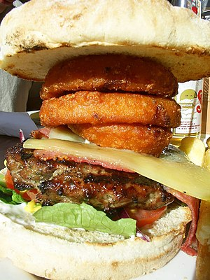Steak burger - A steak burger with cheese and onion rings