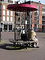 Street- furniture for Found Objects, with sitting Moroccan women on the bench, in the street Kinkerstraat, Amsterdam, 2014.jpg