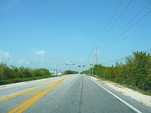 Upper Sugarloaf Key - One of the rare stoplights in the lower Keys Overseas Highway, at Crane Blvd, is on Upper Sugarloaf Key. Crane Boulevard, leads to Sugarloaf Elementary school and Sugarloaf Middle School, residential area of the island and the Great White Heron National Wildlife Refuge with an excellent bicycling trail.