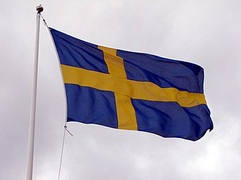 English: The flag of Sweden during a windy day.
