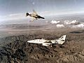 TA-4J Skyhawk and F-4 Phantom during air combat maneuvering 1980.jpg