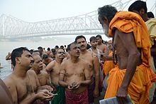 Tarpan is being done at the Jagannath Ghat, Kolkata.
