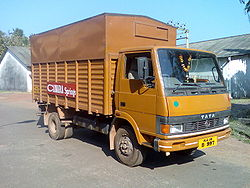 Tata 909 high deck covered rear load area truck