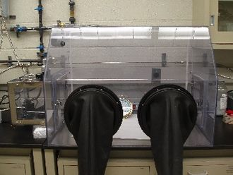 Glovebox - A common rigid-plastic glovebox, seen with gloves turned inside-out