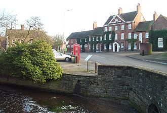 Ollerton - Hop Pole Hotel in Ollerton old village with River Maun in foreground
