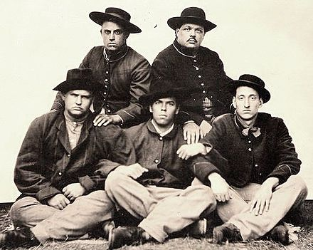 "A tintype showing ""hardcore"" American Civil War reenactors. The Liberty Guards Mess a group of hardcore reenactors, this is a tintype of their Shermans bummers portrayl.jpg"