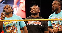 Soldan sağa: Woods, Big E, ve Kingston, WrestleMania Axxess Nisan 2016.