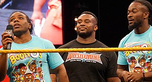 The New Day (wrestling) - From left to right: Woods, Big E, and Kingston at WrestleMania Axxess in April 2016