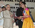 The President, Shri Pranab Mukherjee presenting the Rajat Kamal Award for Best Child Artist (Shared) Thanga Meengal (Tamil) to Sadhma, at the 61st National Film Awards function, in New Delhi on May 03, 2014.jpg