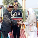 Nazir Wani's wife receiving Ashok Chakra from the President of India