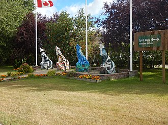 Start of the downtown section of Spirit Way, with 4 of the 56 Spirit Way Wolf statues. Thompson - Spirit Way.jpg