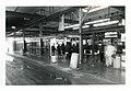 Ticket booth and turnstiles, south busway, looking northwest, Fields Corner MBTA station (24869994054).jpg